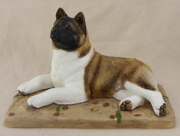 Lying Akita Sculpture By Cavacast