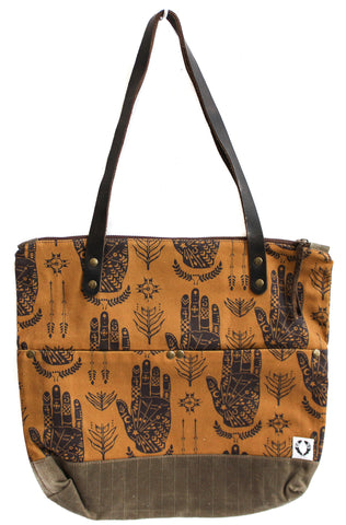 Hands on burnt amber Islander Tote