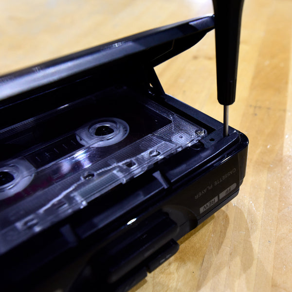 Can I adjust the tape speed of my portable cassette player on my own?