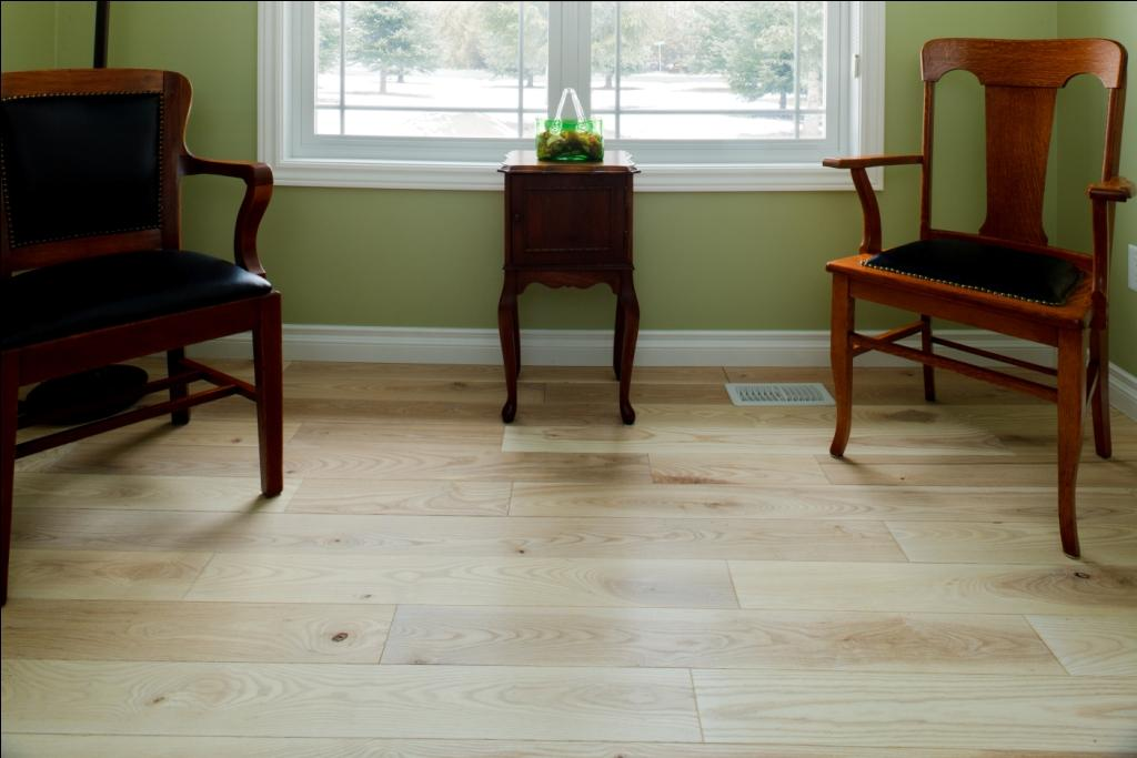 whitewash wood flooring with dark furniture