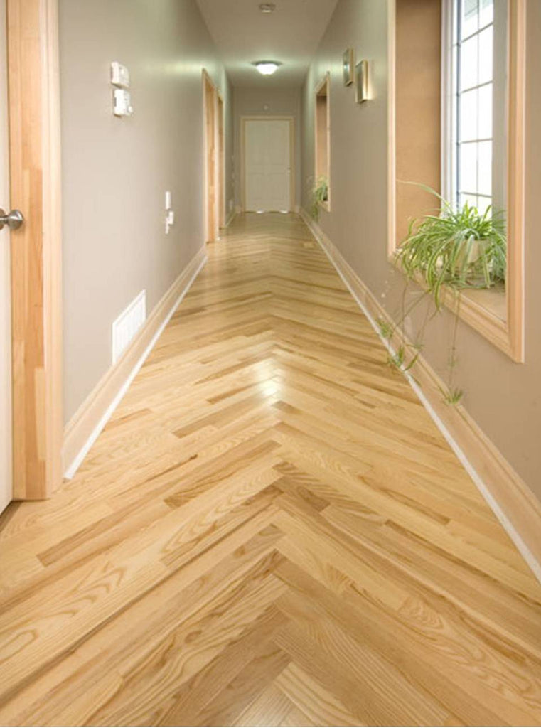 hardwood flooring in a hallway in a unique pattern