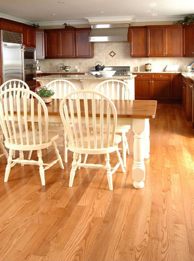 light stained wood flooring with dark kitchen cabinets
