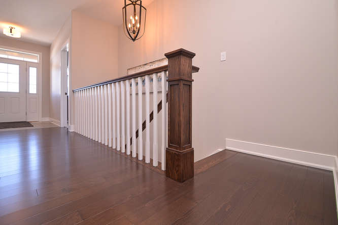hardwood flooring with white spindel stairs