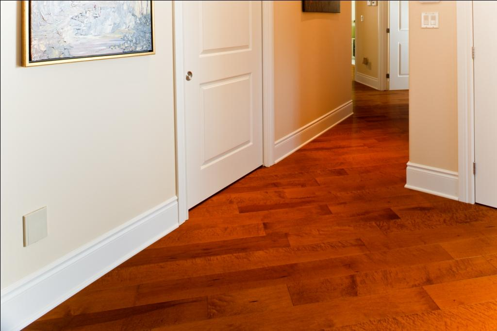 close up image of birdseye maple flooring in a medium tone