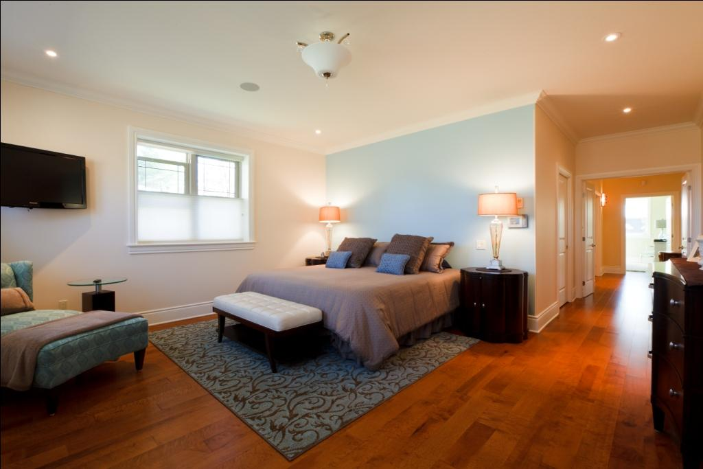 medium toned custom birdseye maple hardwood flooring with a bed
