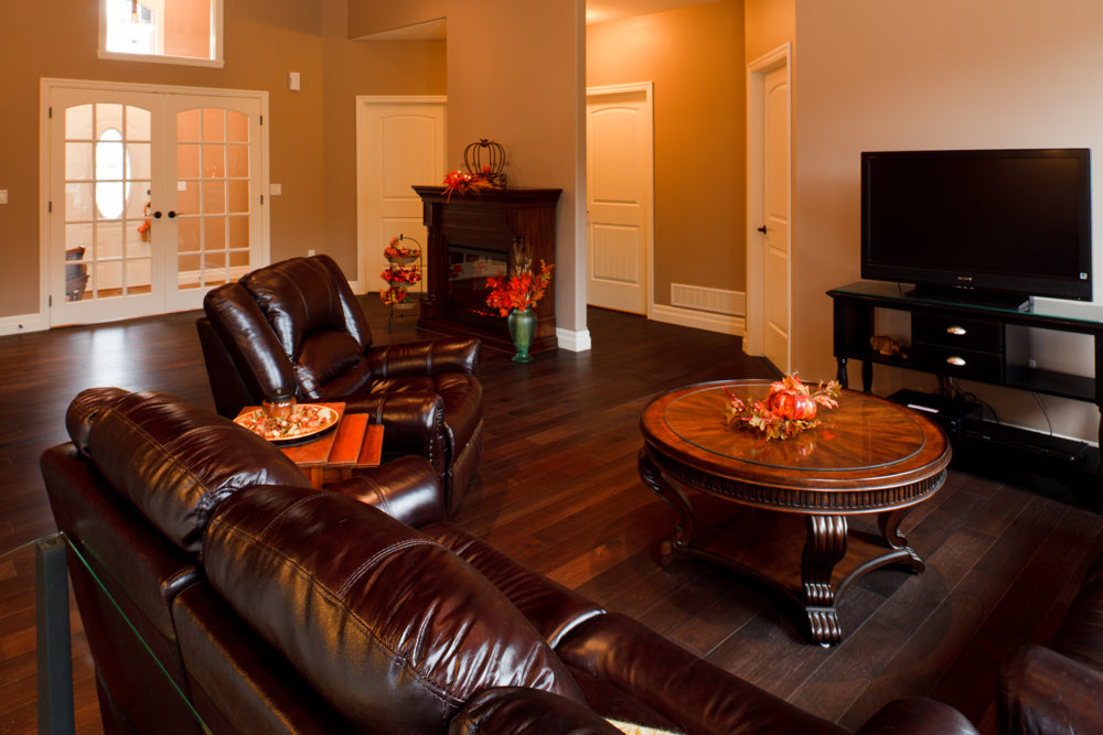 dark hickory hardwood flooring with leather furniture
