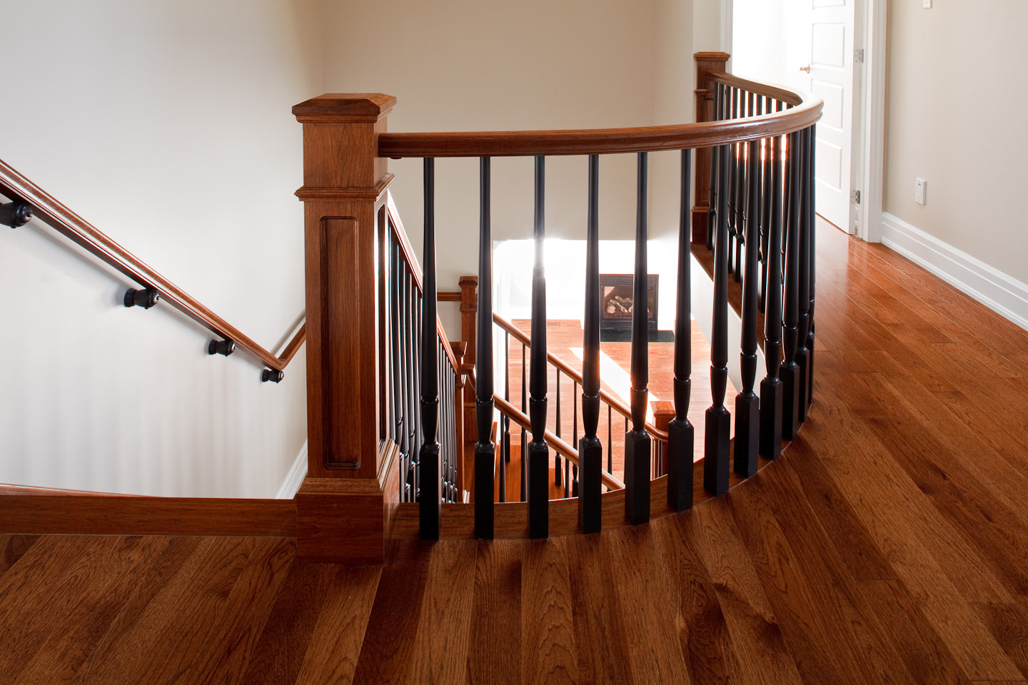 Hickory hardwood flooring with dark spindle stairs