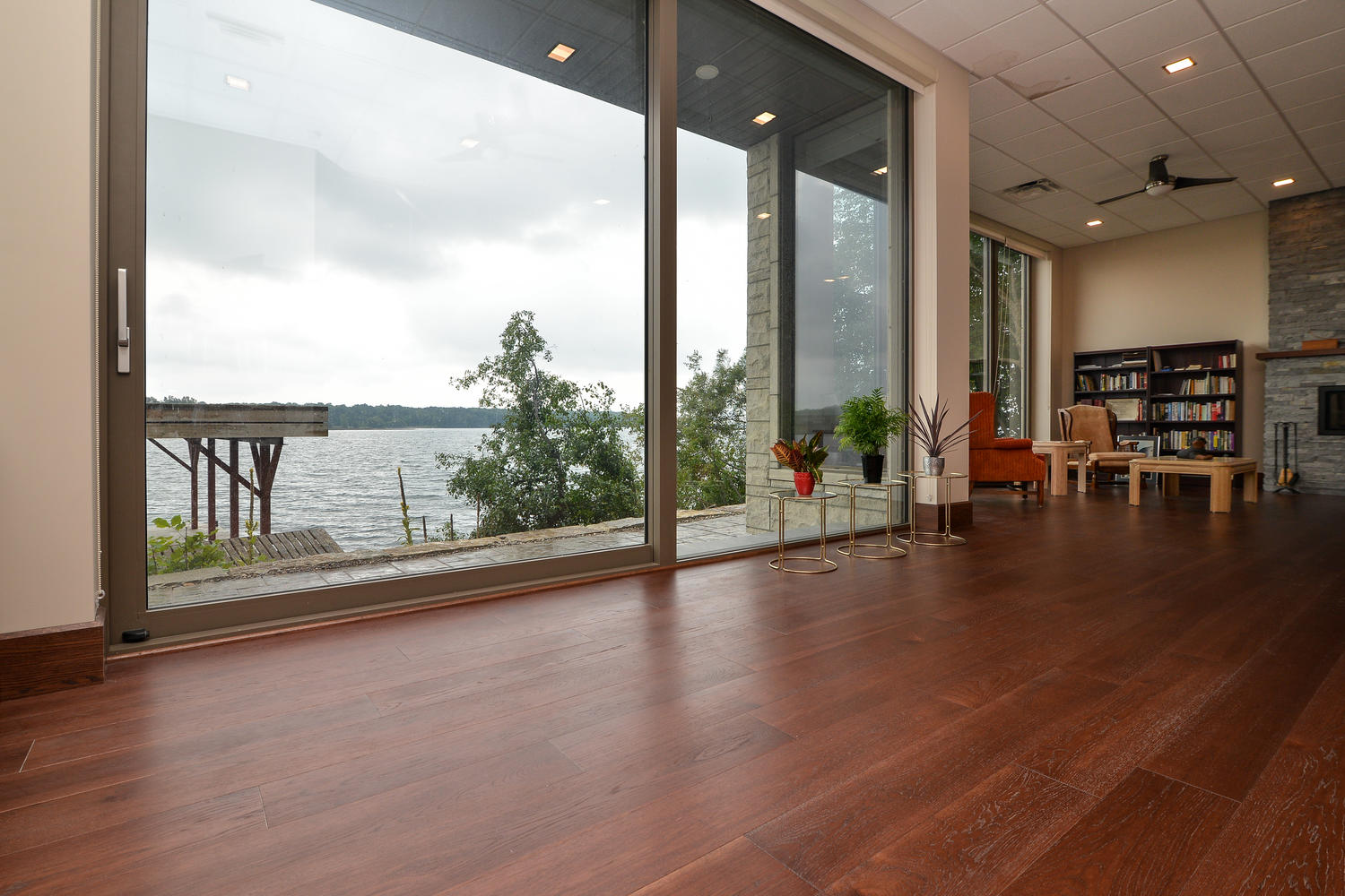 Hickory Wood Flooring in a home with full wall windows
