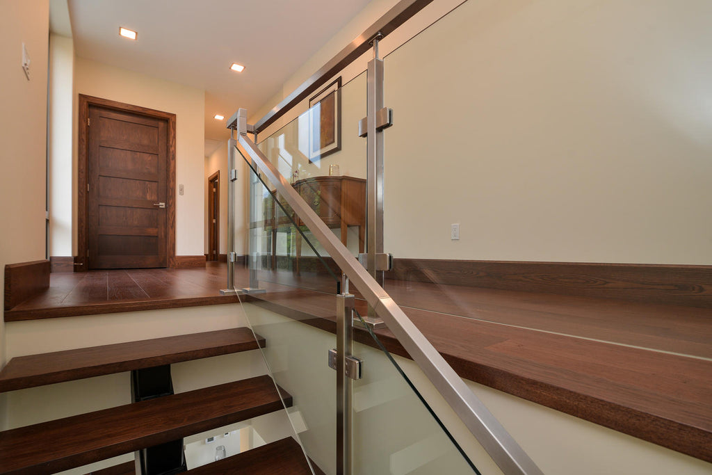 Hickory wood flooring with a glass staircase