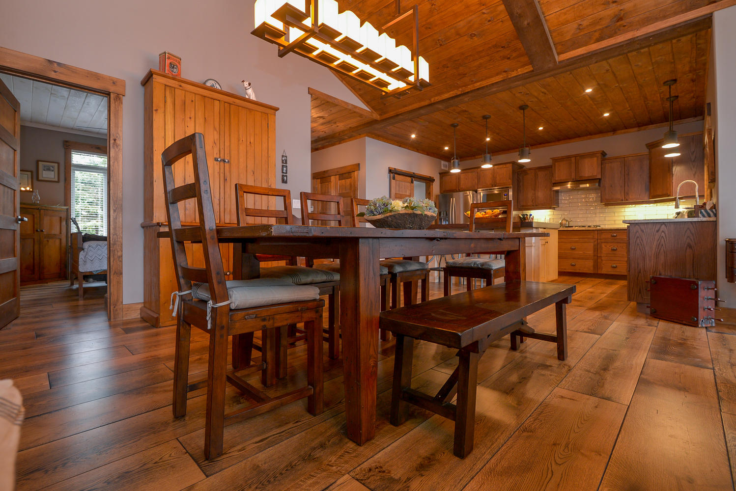 Pictures of Wide plank white oak flooring in a full kitchen