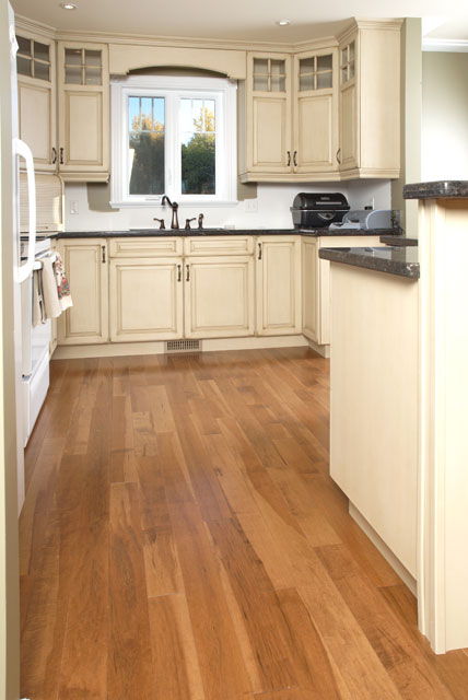 off white kitchen cabinets with a rustic wood flooring