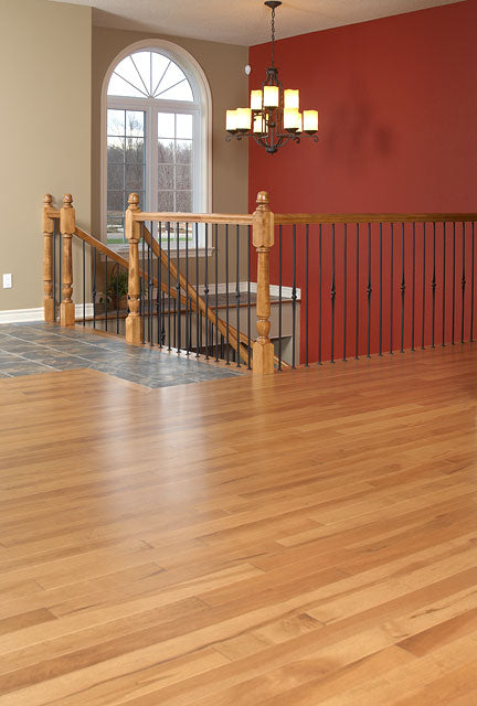 Maple antique wood flooring in a medium tone