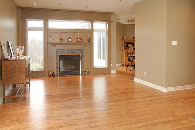 antique maple wood flooring with a fireplace