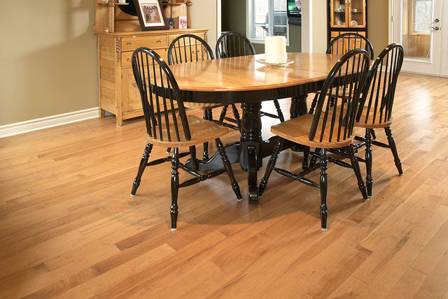 rustic hardwood flooring with a dark dining table