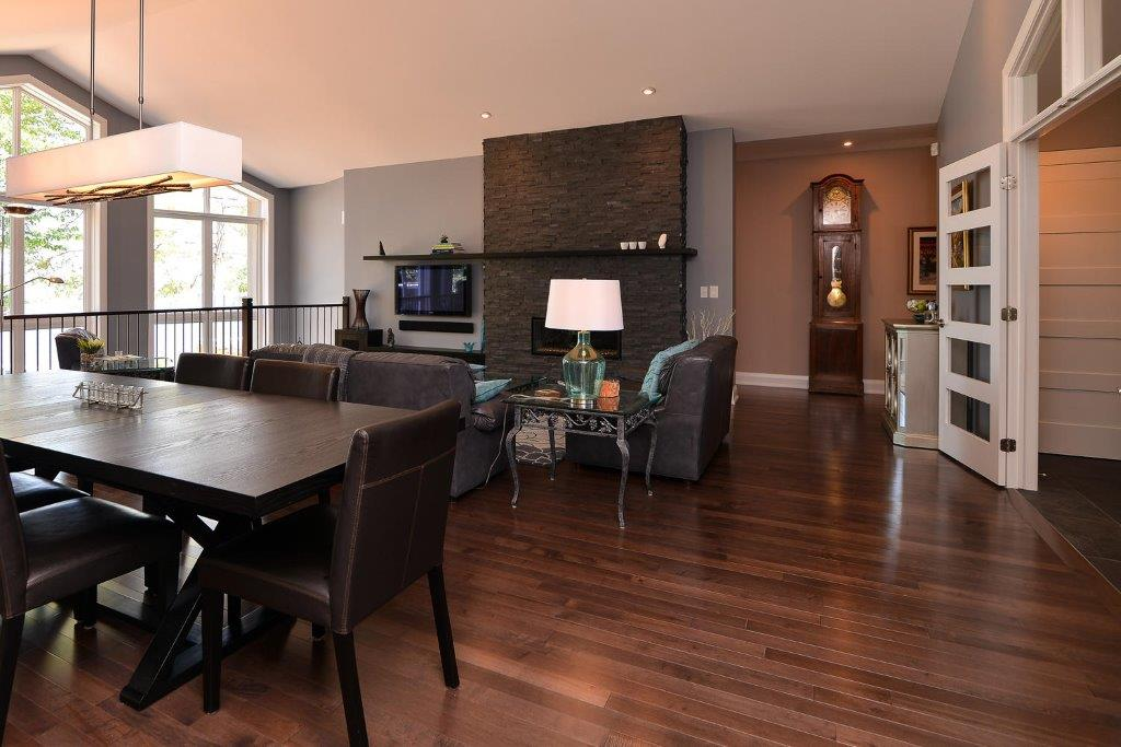 Dark Maple Hardwood Flooring with a Dark Kitchen Table