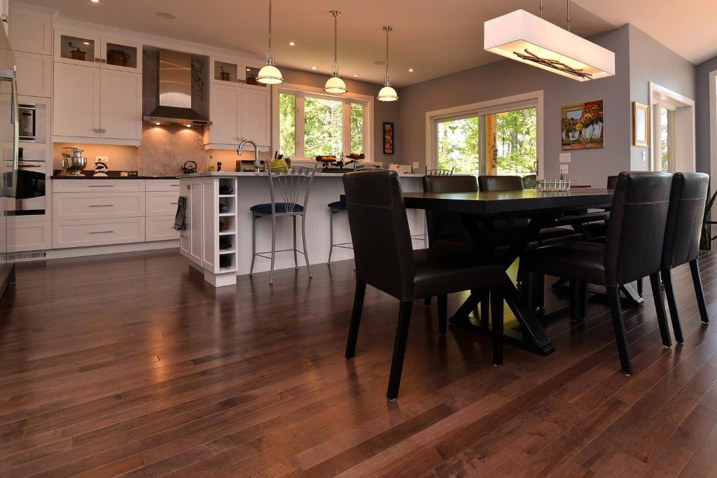 Maple Hardwood Flooring with a black kitchen table