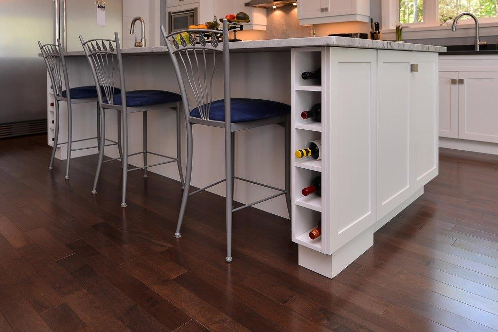Maple Flooring in a Kitchen with a White Island