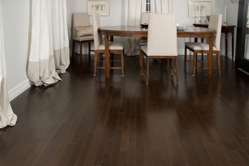 Dark hardwood flooring with white walls