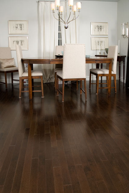dark maple flooring with light dining chairs