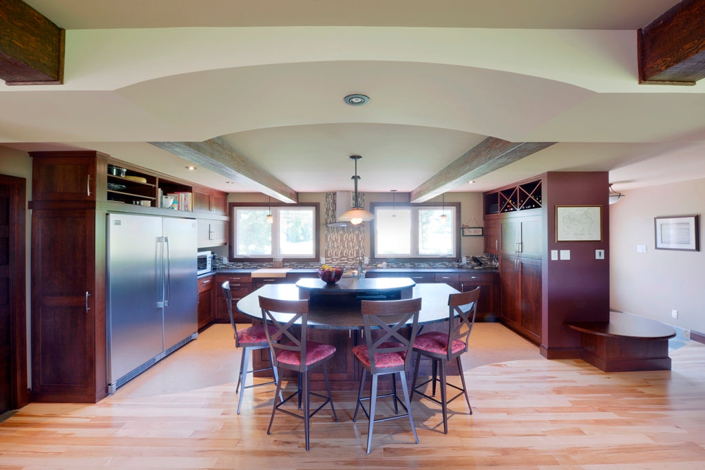 natural maple with dark kitchen cabinets and hardwood flooring