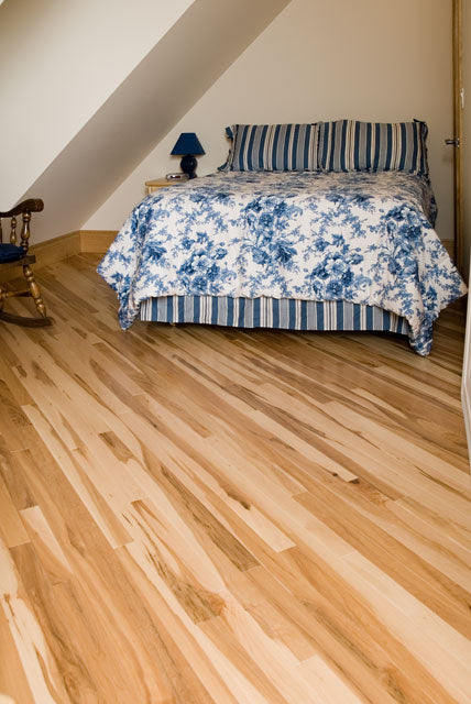rustic maple wood flooring in a bedroom setting