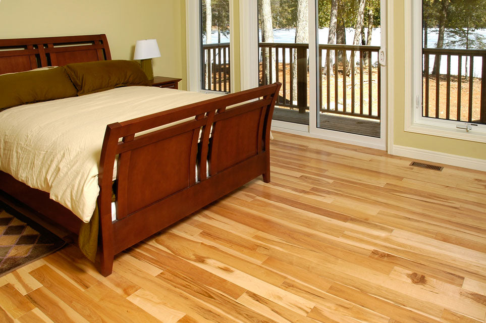 light maple flooring with a dark bed