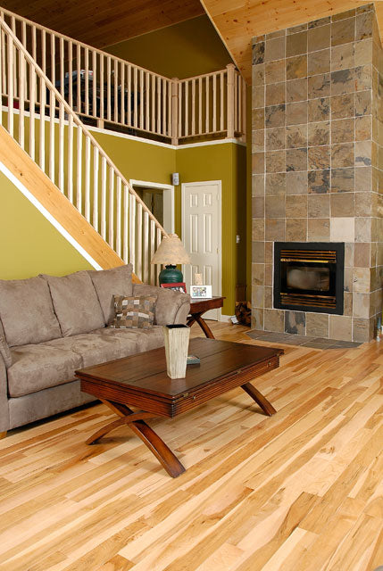 Maple natural hardwood flooring in a modern living room with a fireplace