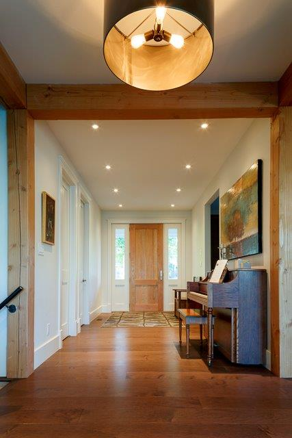 beams with a wide plank hardwood floor