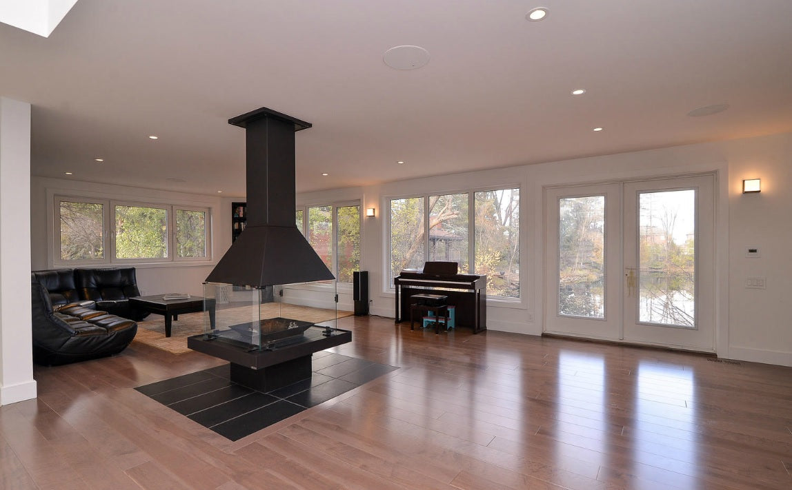 center of room fireplace with hardwood flooring
