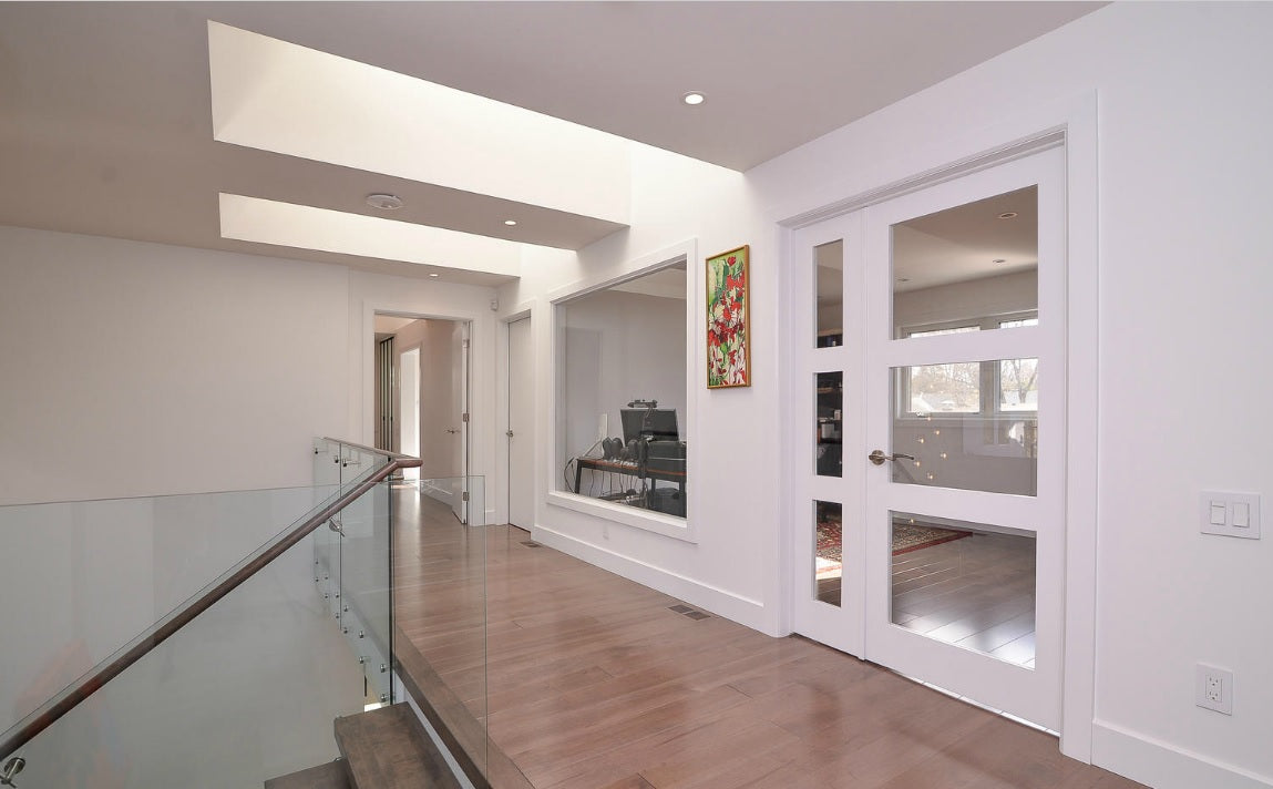 glass stair case with wood flooring