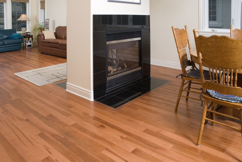 medium tone wood flooring with a fireplace