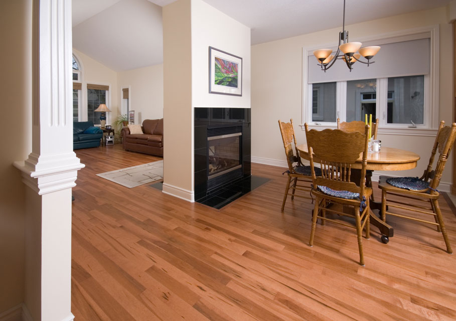 red maple hardwood flooring with a fireplace