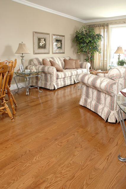 wide plank red oak wood flooring in a living room