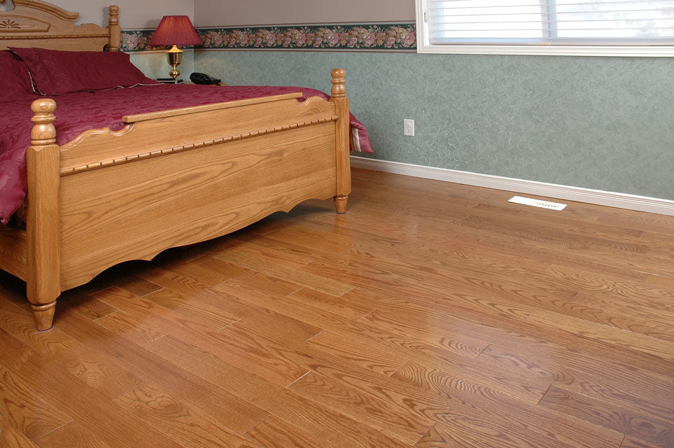 light stained red oak hardwood flooring in a bedroom