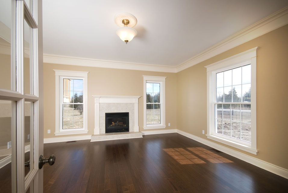 dark oak flooring with a white fireplace