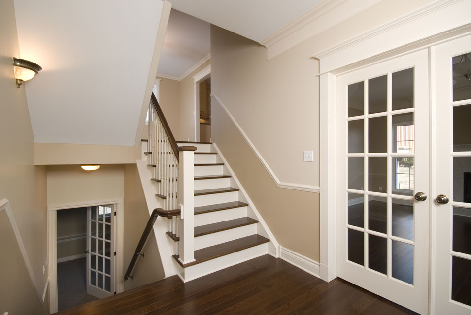 dark flooring on stairs with white risers
