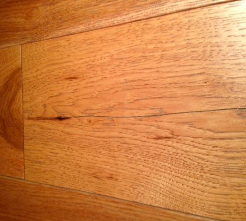 Cracked wood flooring board