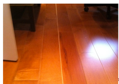 Spacing between wood flooring boards