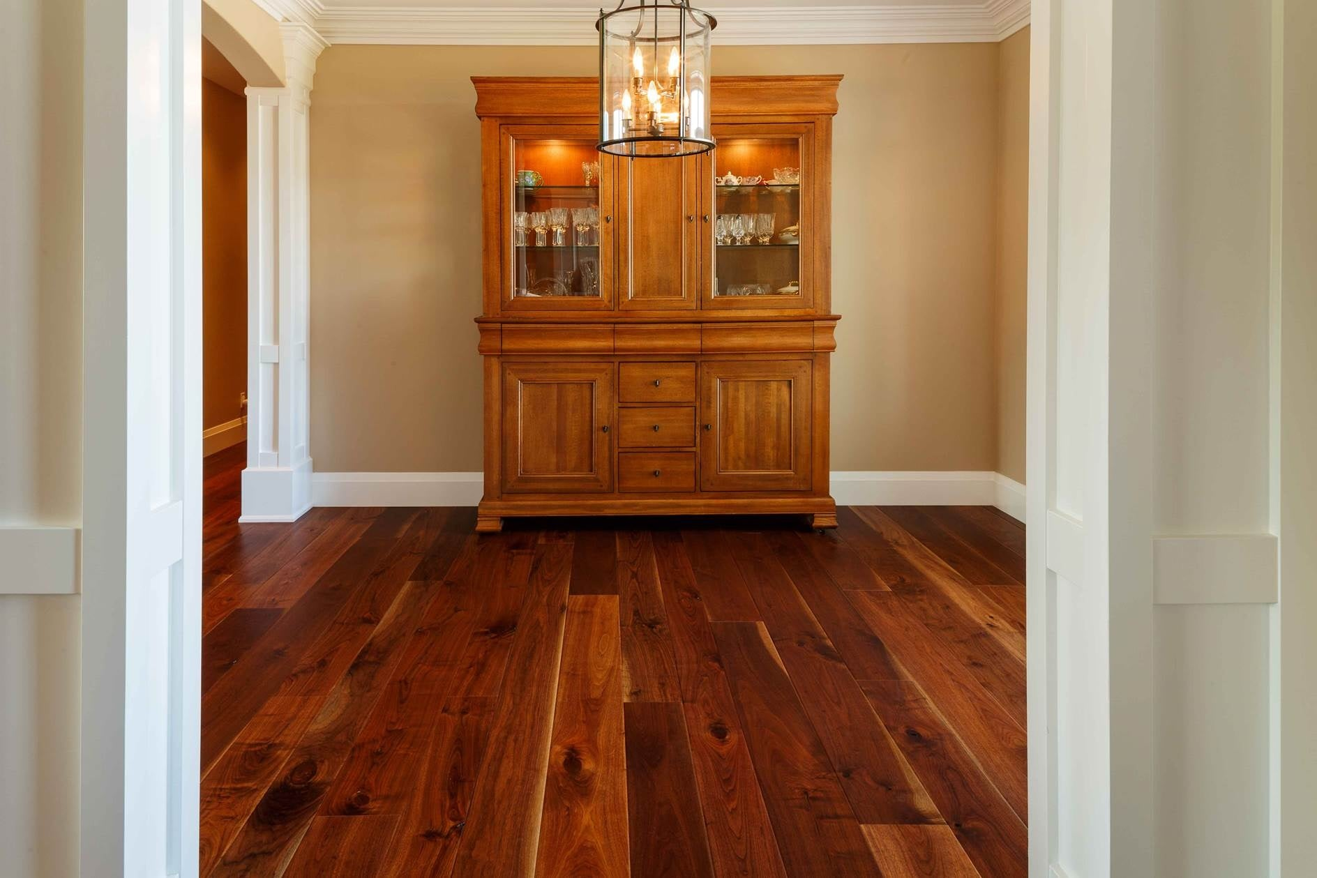 walnut wood flooring with a transition