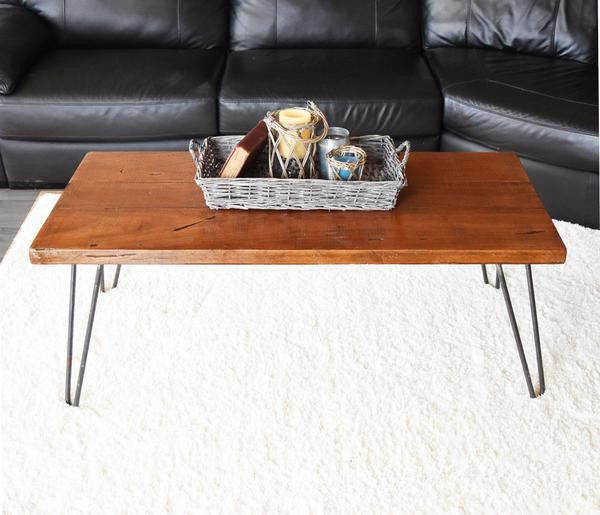 Reclaimed Wood Coffee Table Placed In Front Of Sofa