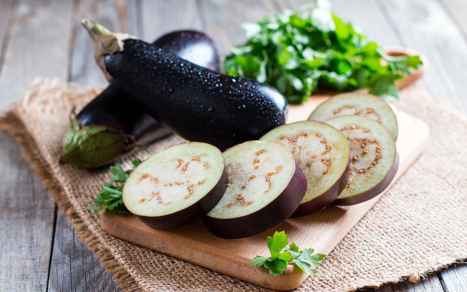 Whole and Sliced Eggplant