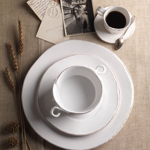 Vietri Lastra Small Handled Bowl in White as part of a setting with wheat and coffee