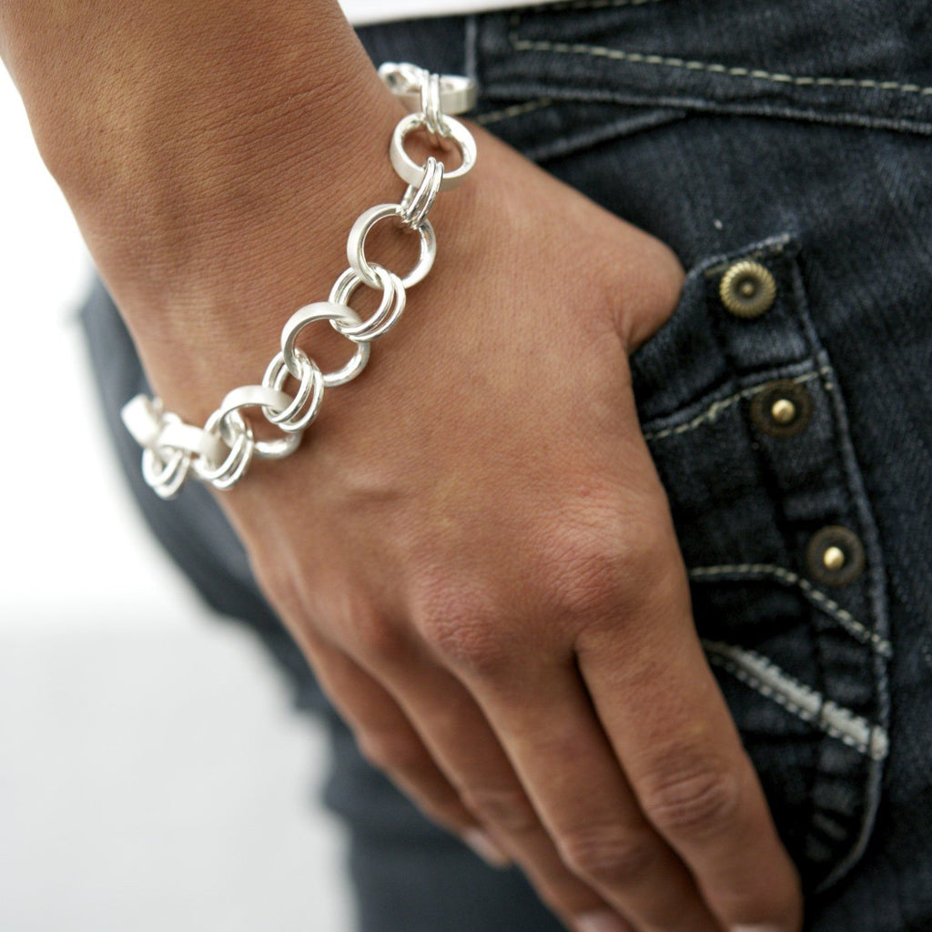 Sterling silver small ring bracelet on the wrist