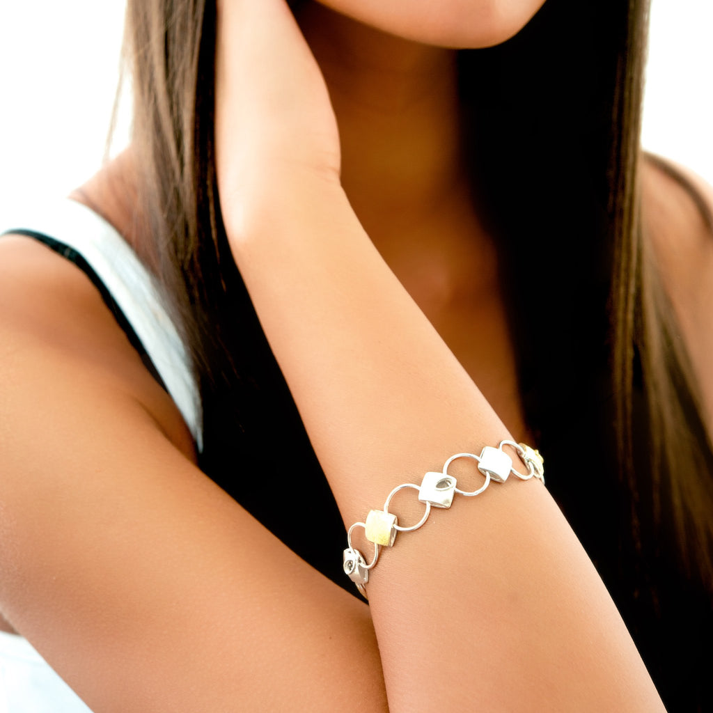 Silver cushion bracelet on model