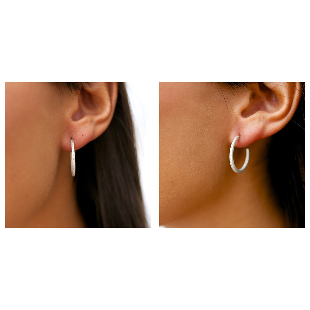 Sterling silver skinny dotty earrings on the ear