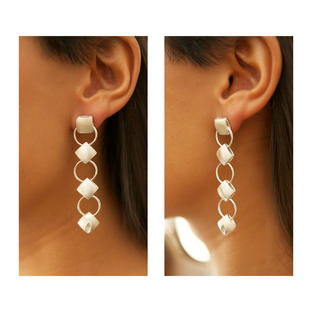close up cushion silver chandelier earrings