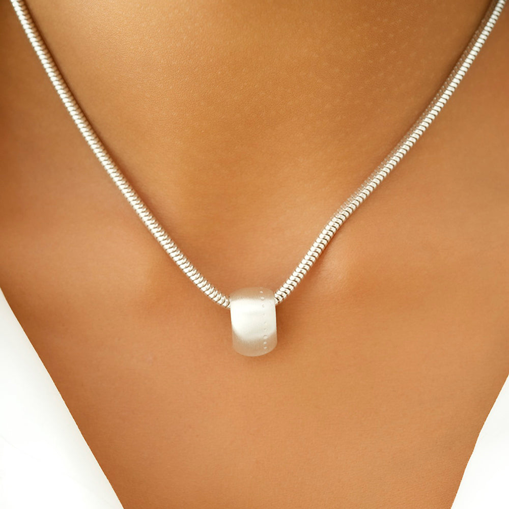 Dotty Silver Teardrop Pendant Necklace