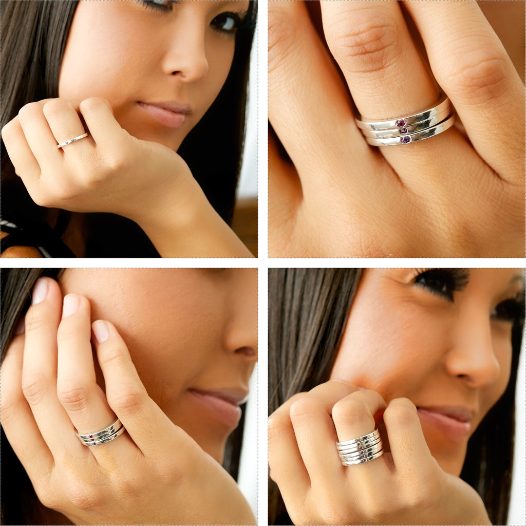 Silver birthstone stacking rings on model