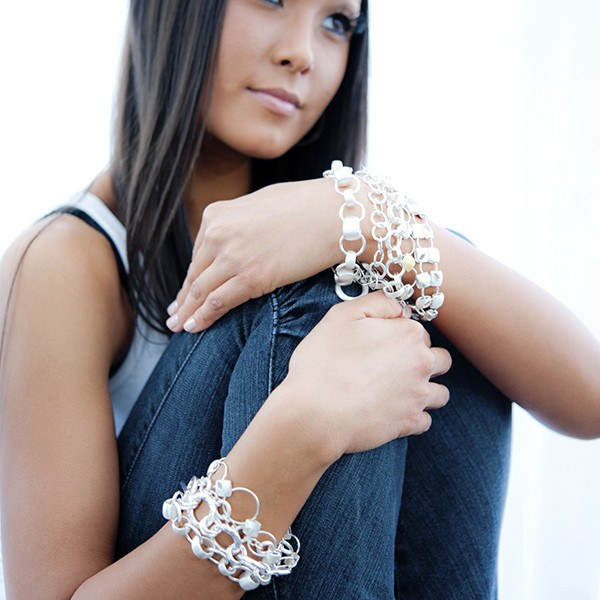 TLK bracelets shown on model