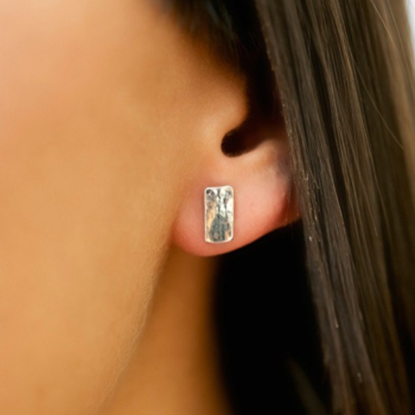 Contemporary silver rectangle stud earrings on model